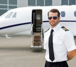 Pilot standing near a private jet
